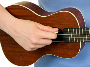 Right Hand Strumming the Ukulele with a Pick