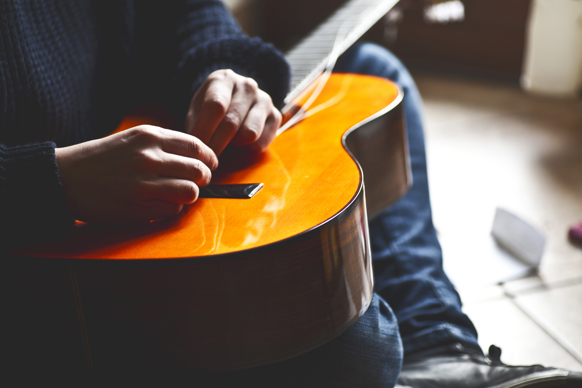 How to Change Guitar Strings on Acoustic Guitar